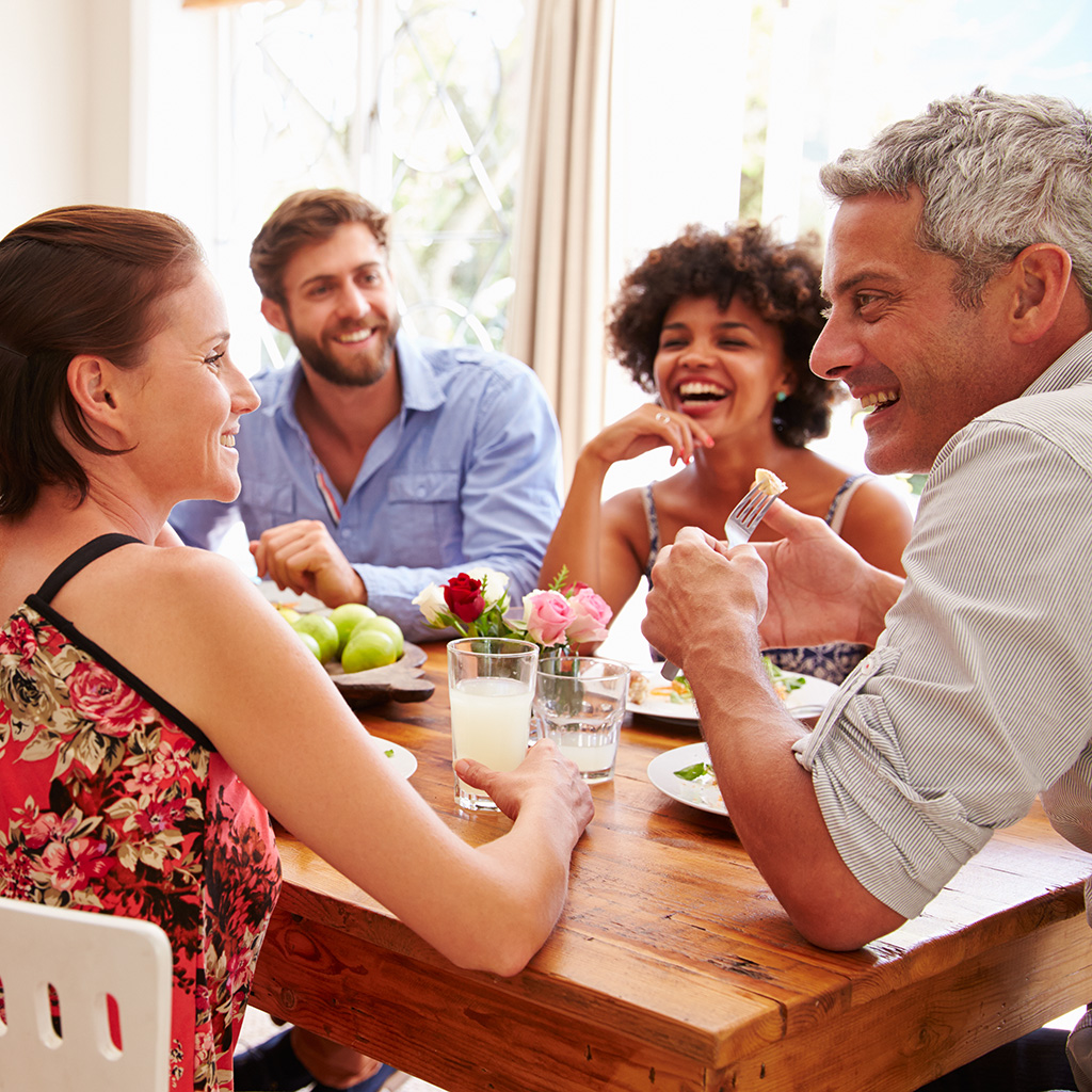 diverse adults talking around a table