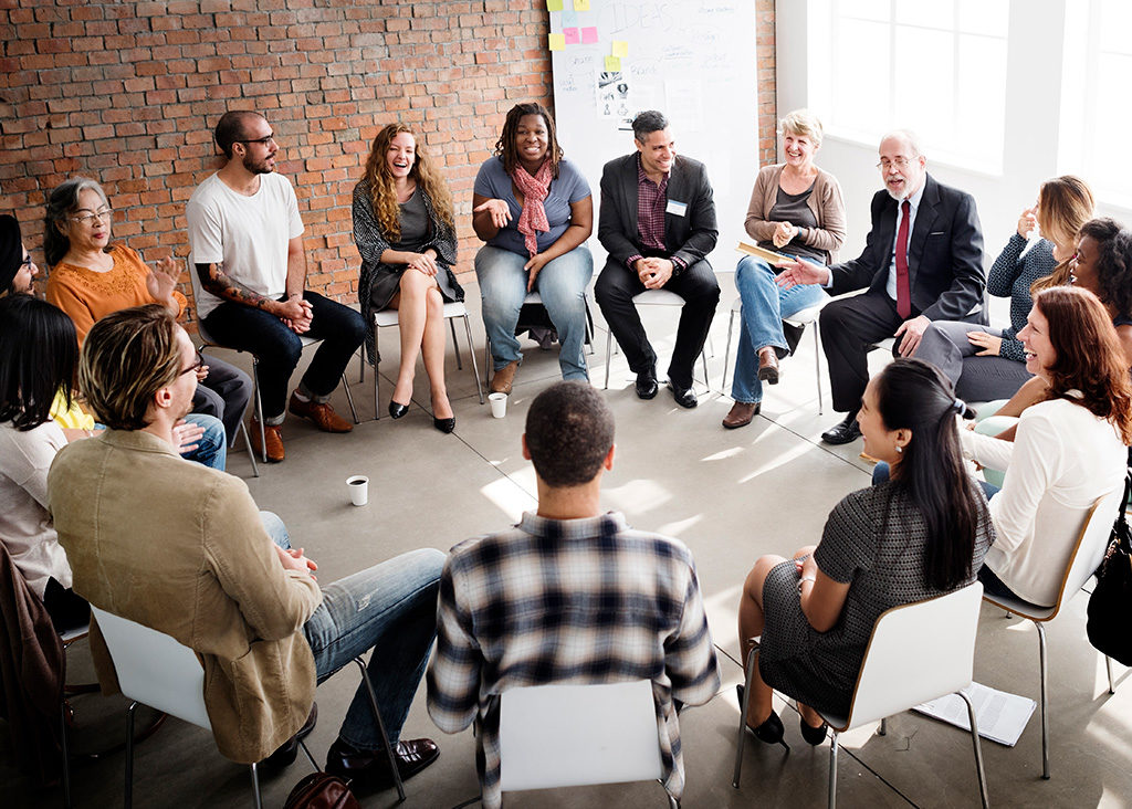 Group of people seated in discussion circle